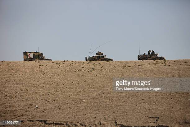 afghan army convoy drives along the wadi ridge in afghanistan. - glen ridge officer stock pictures, royalty-free photos & images