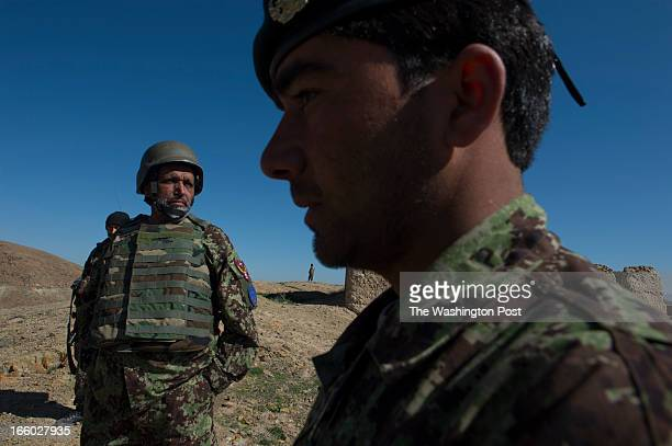 Afghan Army General Abdul Raziq left and 1st Lt Musif Khan right survey an area where recent kidnappings and Taliban activities have occurred in the...