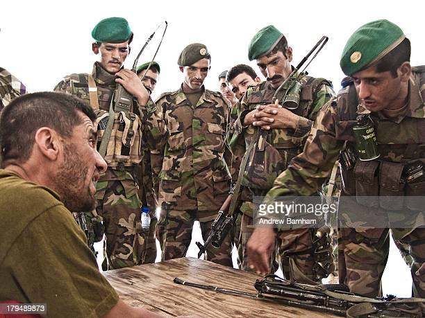 CONTENT] Afghan Army lieutenant briefing his sergeants prior to a joint patrol with British Forces