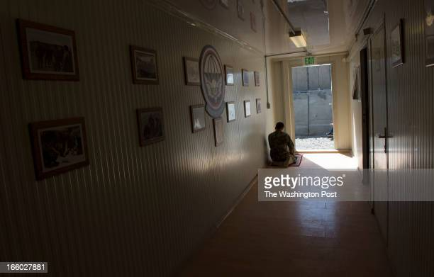 Afghan Army sergeant Sayeed Rahman prays in the afternoon in the hallway of the joint ISAF International Security Assistance Force and Afghan Army...