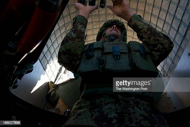 Afghan Army soldier Hijrat Ajez on patrol in an American humvee outfitted with a machine gun turret on March 30 2013 on the Kabul Paktia Hwy in Logar...