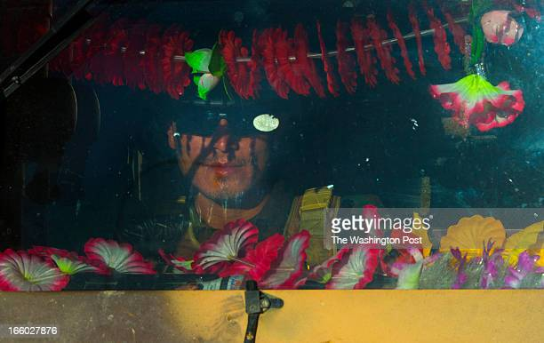 Afghan Army soldier Nasrullah Ghamkhor prepares to patrol in an American humvee with the windshield decorated with plastic flowers on Saturday March...