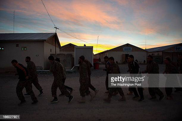 Afghan Army soldiers begin their early morning exercise on the Afghan Army Camp Maiwand in Logar Province Afghanistan on March 29 2013 Afghan Army...