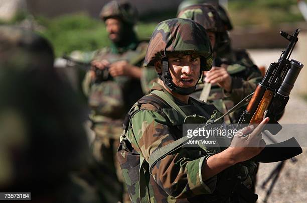 Afghan Army soldiers patrol March 14, 2007 in Kajaki, Helmand province, Afghanistan. Afghan troops, along with British Marine trainers, patroled...