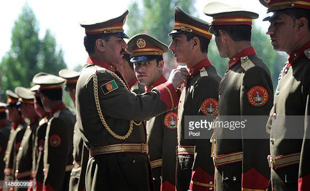Afghan Army soldiers prepare for a ceremonial welcome of British Prime Minister David Cameron with Afghan President Hamid Karzai at the Presidential...