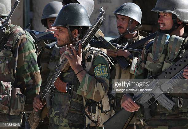 Afghan Army soldiers stand at attention during a ceremony at Forward Operating Base Nawbahar Saturday November 14 2009