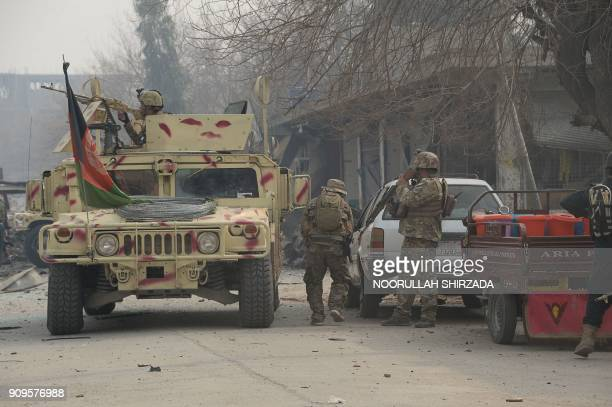Afghan army soldiers take positions near an office of the British charity Save the Children during an ongoing attack in Jalalabad on January 24 2018...