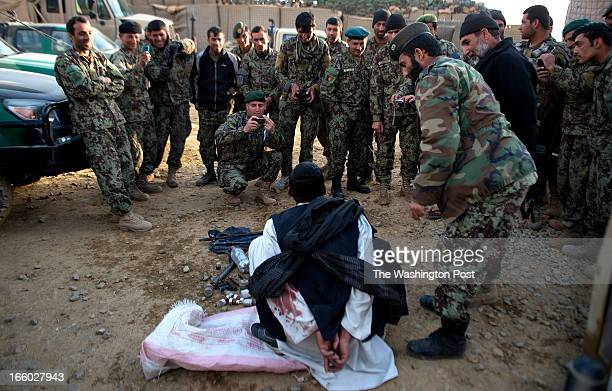 Afghan Army soldiers taunt man known as 'Wazir' a suspected Taliban who was taken prisoner on Tuesday April 2 2013 in Wardak Province Soldiers say...