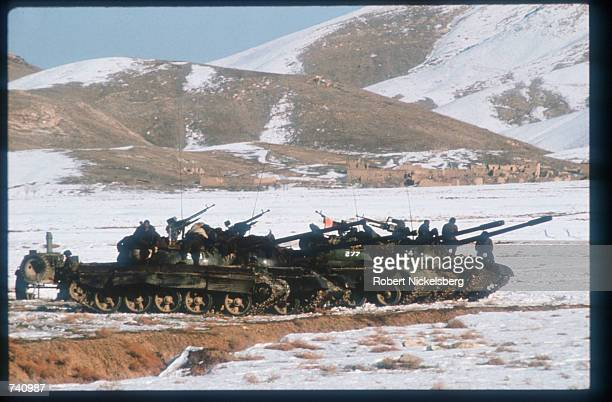 Afghan Army tanks patrol the road used during Soviet evacuation January 14 1989 near Kabul Afghanistan The end of Soviet military occupation which...
