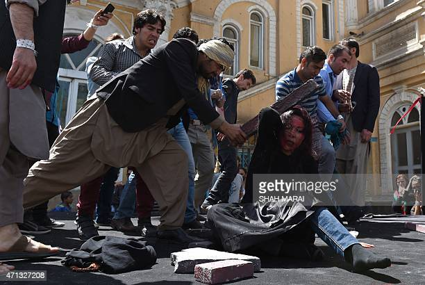 Afghan artists on April 27 2015 perform a role play to depict the lynching of Afghan woman Farkhunda who was attacked by an angry mob in Kabul...