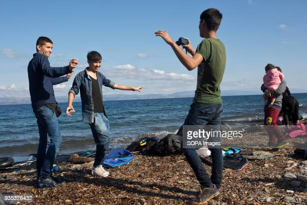 Afghan asylumseekers dance to music playing on their mobile phones celebrating their safe arrival after crossing the Aegean Sea In 2015 more than a...