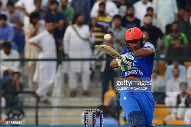 Afghan batsman Hashmatullah Shaidi plays a shot during the one day international Asia Cup cricket match between Pakistan and Afghanistan at The...