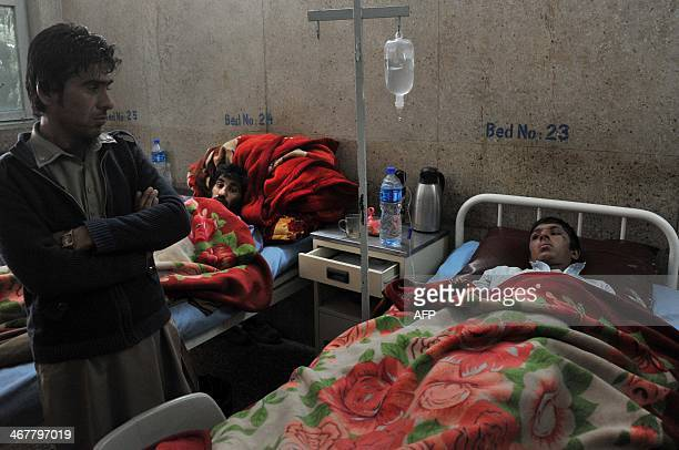 Afghan blast victims are treated at a hospital after an explosion in Jalalabad capital of Nangarhar province on February 8 2014 At least one child...