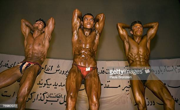 Afghan bodybuilders in the 5560kg category compete during a regional bodybuilding competition August 6 2007 in Kabul Afghanistan Bodybuilding is a...