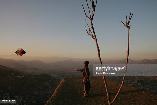 Afghan boy flies a kite on top of a hill overlooking Kabul November 23 2006 in Kabul Afghanistan Kabul is now still in transition five years after...