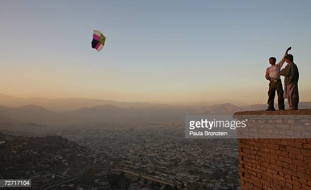 Afghan boys fly a kite on a hill overlooking Kabul November 23, 2006 in Kabul, Afghanistan. Kabul is now still in transition five years after the...