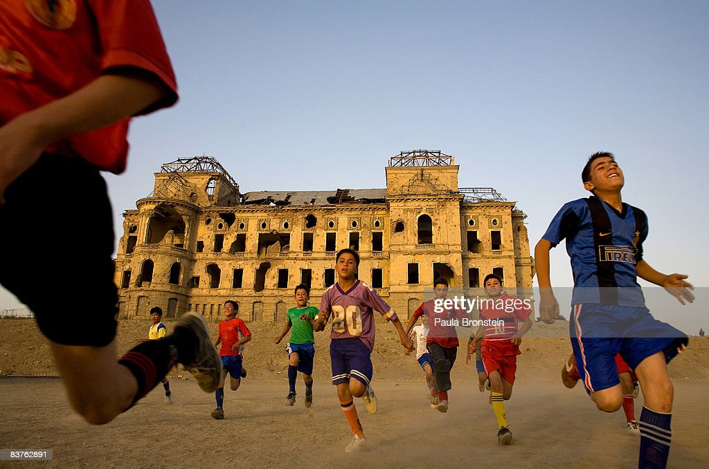 Afghan boys get warmed up before a game of soccer using a field adjacent to the ruins of the Darlaman Palace on August 27, 2007 in Kabul, Afghanistan.