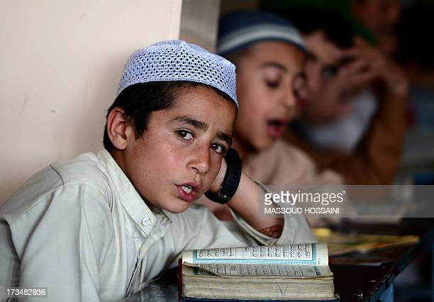 Afghan boys learn and memorize the Koran at a Madrassa during the holy month of Ramadan in Kabul on July 15 2013 Throughout the month devout Muslims...