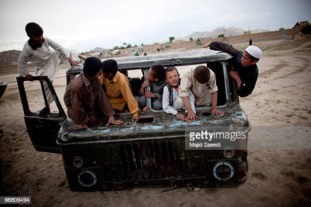 Afghan boys on the outskirts of Kabul play inside a destroyed tank left over from the 19791989 Russian invasion on May 2 2010 in Afghanistan 'This...