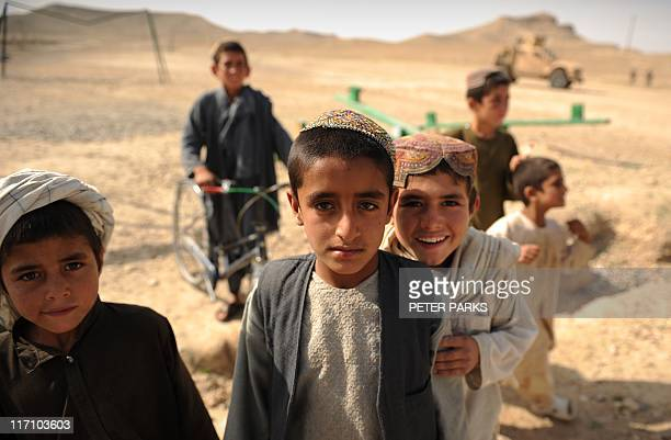 Afghan boys play near the town of Musa Qala in Helmand province in southern Afghanistan on April 12 2011 Afghanistan said recently its forces would...