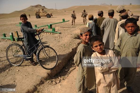 Afghan boys play near the town of Musa Qala in Helmand ...