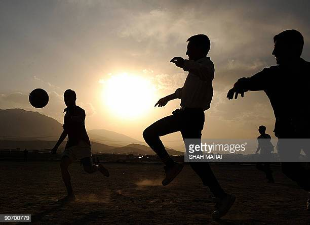 Afghan boys play soccer at sunset in Kabul on September 13 2009 Football is one of the most popular games in Afghanistan and is played on dusty dry...