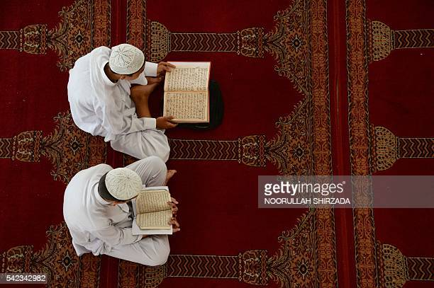 TOPSHOT Afghan boys study the Koran during the Islamic holy month of Ramadan at a mosque in Jalalabad on June 23 2016 Muslims throughout the world...