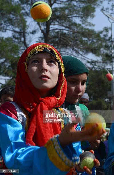 Afghan children from The Mobile Mini Circus for Children juggle with balls during a circus show in Herat on October 7, 2015. AFP PHOTO/Aref KARIMI