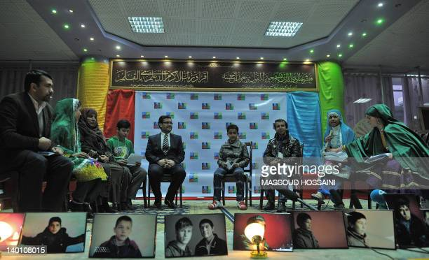 Afghan children from the Mobile Mini Circus for Children sit with Afghan's officials to talk about their future plans for children at Afghanistan's...