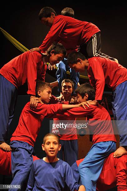 """Afghan children from The Mobile Mini Circus for Children take part in a performance on child labour to honour """"World Day Against Child Labour"""" at The..."""