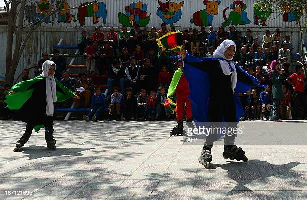 """Afghan children from The Mobile Mini Circus for Children take part in a performance to honour """"World Circus Day"""" at their Centre in Kabul on April..."""