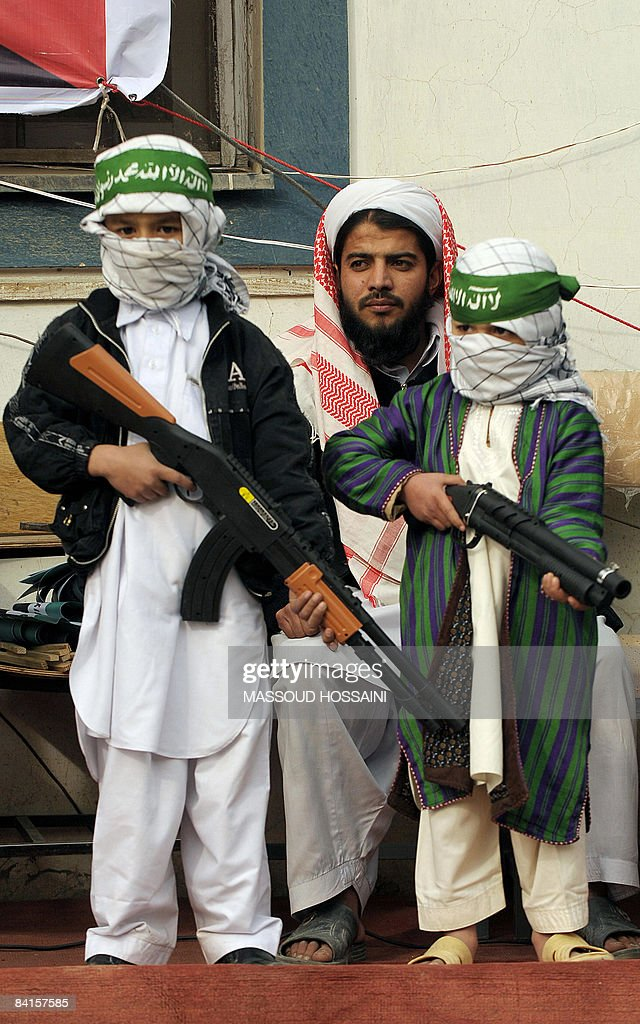 Afghan children hold toy guns during a demonstration against Israeli strikes in Gaza outside a Mosque in Kabul on January 2, 2009. Amid mushrooming protests around the globe, the world's top diplomats scrambled to find a way to end one of Israel's deadliest-ever offensives on Gaza that has so far killed at least 400 Palestinians. AFP PHOTO/Massoud HOSSAINI