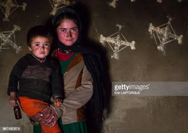 Afghan children in front of nowruz decorations on the walls Badakhshan province Zebak Afghanistan