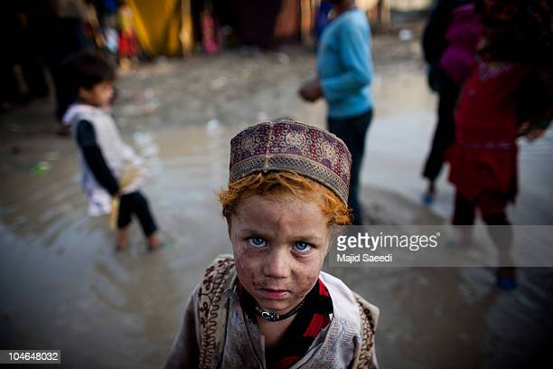 Afghan children live in a refugee camp in Karti Parwan district on October 1 2010 in Kabul Afghanistan Since 2001 more than a million Afghan refugees...