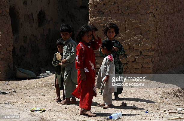Afghan children look on in Kote Tazagul area in Marjah district in Helmand Province on May 24 2011 US lawmakers saw momentum for political...