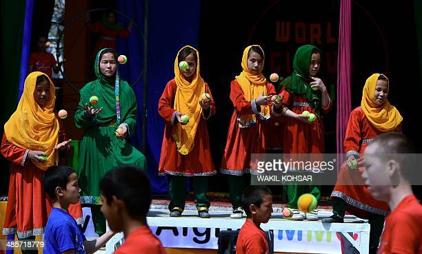 Afghan children of The Mobile Mini Circus for Children perform in Kabul on April 20, 2014. Children from The Mobile Mini Circus for Children...