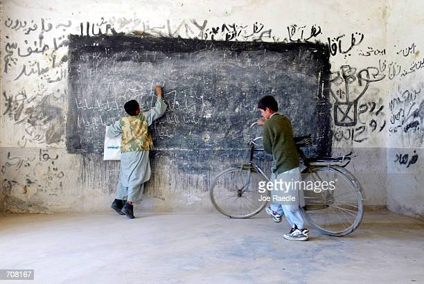 Afghan children play in a classroom April 18 2002 near the Bagram Air Base in Afghanistan The school is scheduled to be renovated in the near future...