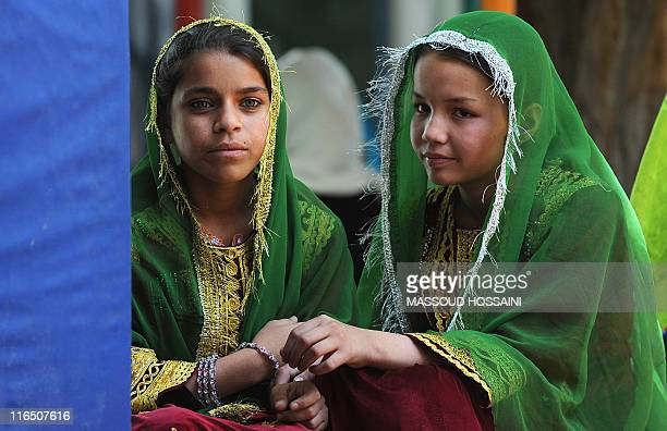 Afghan children rehearse for a performance on child labour at the Afghan Mobile Mini Circus for Children in Kabul on June 11, 2011. The Mobile Mini...