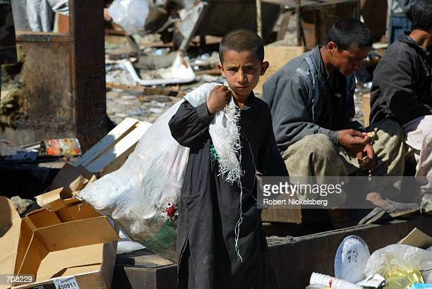 Afghan children root through refuse dumped by the U.S. Military and pull out whatever can be reused or sold off April 10 , 2002 at a landfill near...