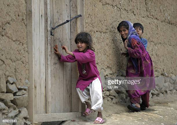 Afghan children run away as US Army soldiers patrol in Naray, in the eastern Kunar province on April 13, 2009. US President Barack Obama, unveiling...
