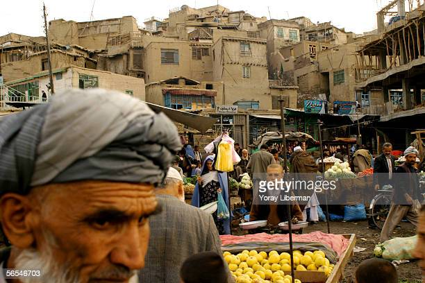 Afghan children sell apples in the street market on April 10 2004 in Kabul Afghanistan