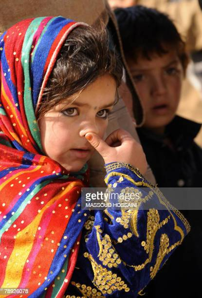 Afghan children wait before communicating via videoconference with relatives held at the US base in Bagram at the International Committee of the Red...