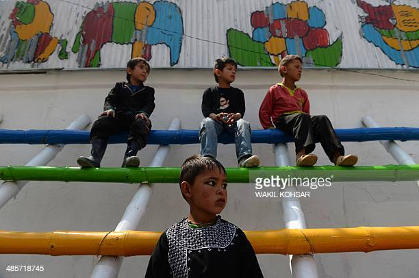 Afghan children watch a performance of The Mobile Mini Circus for Children in Kabul on April 20, 2014. Children from The Mobile Mini Circus for...