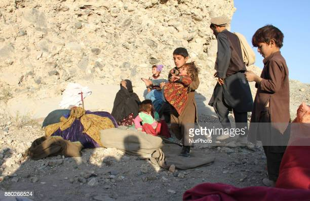 Afghan children who along with their families have been displaced due conflicts between Taliban militants and Islamic State take shelters on the...