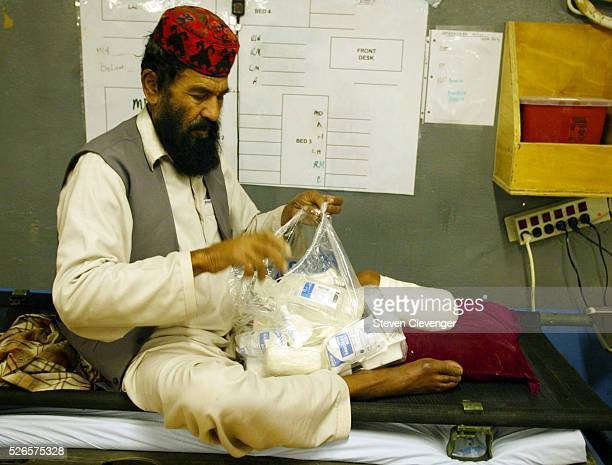 A Afghan civilian who had his foot amputated seven weeks earlier at the FOB OrgunE hospital returns for a follow up appointment The man's story was...