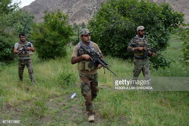 Afghan commando forces patrol at the site of US bombing in the Achin district of Nangarhar province on April 23 2017 Afghan authorities April 15...