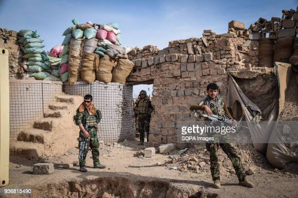 FARAH AFGHANISTAN Afghan Commandos inside the remains of an Afghan National Defence and Security Forces outpost behind Farahrud Bazaar just off the...