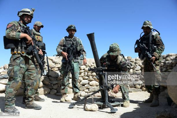Afghan commandos prepare to launch mortar shells on an Islamic State militant stronghold in Achin district of Nangarhar eastern Afghanistan on April...