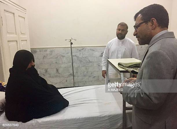 Afghan Consul General in Peshawar Abdul Waheed Poyan talks with Afghan woman Sharbat Gula known internationally as the 'Afghan Girl' who appeared on...