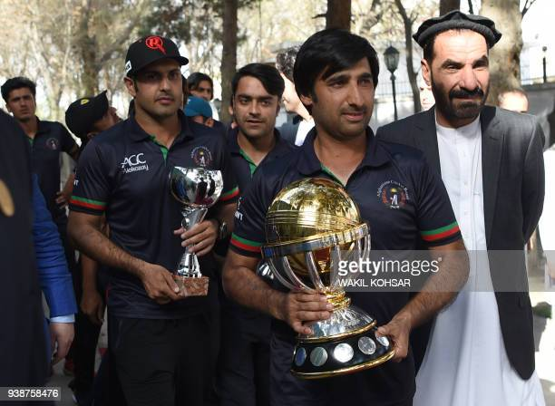 Afghan cricket captain Asghar Stanikzai and teammates Rashid Khan and Mohammed Nabi arrive for an event to celebrate the Afghan national team...
